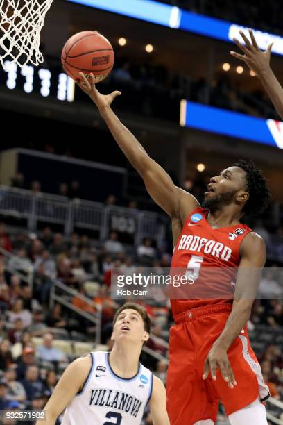 Donald Hicks of the Radford Highlanders shoots the ball against Dhamir CosbyRoundtree of the Villanova Wildcats during the first half of the game in...