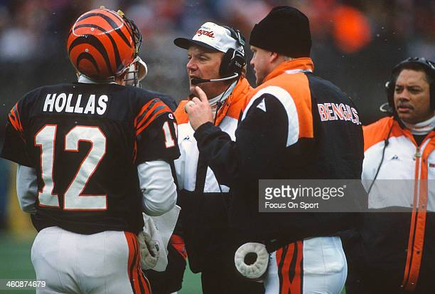Donald Hollas of the Cincinnati Bengals talks with head coach Sam Wyche against the Los Angeles Raiders during an NFL football game November 24 1991...