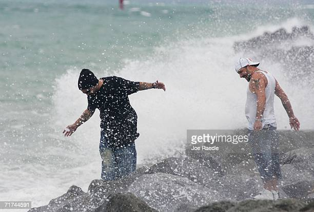 Donald Hollingsworth and Mark Hollingsworth are sprayed with ocean water as the ocean is churned up by the approaching Tropical Storm Ernesto August...