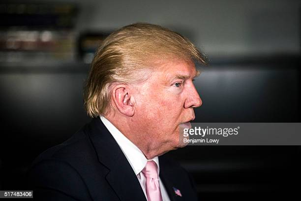 Donald J. Trump, candidate for the Republican presidential nomination, is interviewed by a reporter following a campaign rally at the Radford...