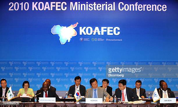 Donald Kaberuka president of the African Development Bank left walks with Yoon Jeung Hyun South Korea's minister of strategy and finance center...
