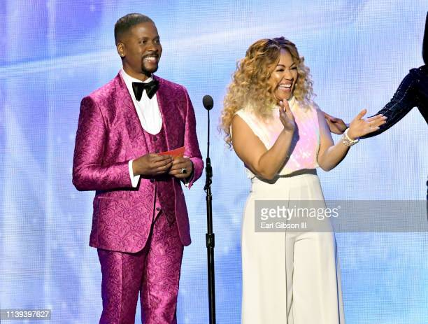 Donald Lawrence and Erica Campbell present the Female Vocalist of the Year award during the 34th annual Stellar Gospel Music Awards at the Orleans...