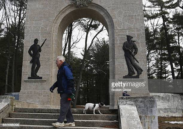 Donald Leary of Abington walks his dog Grace at Island Grove Park in Abington MA on Jan 27 2016