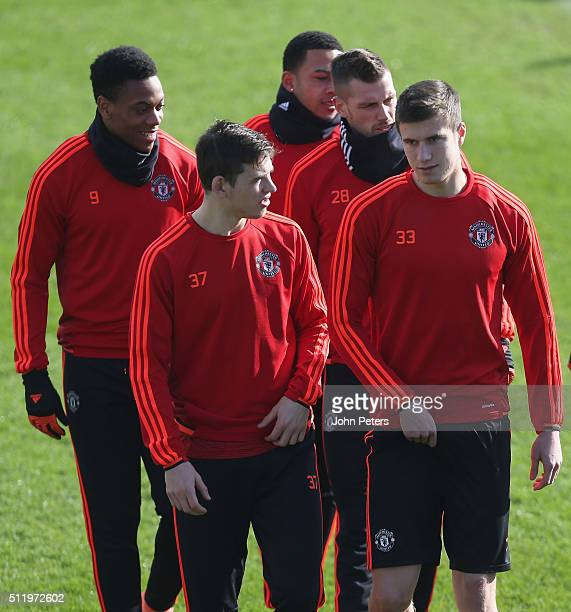 Donald Love and Patrick McNair of Manchester United in action during a first team training session at Aon Training Complex on February 24 2016 in...