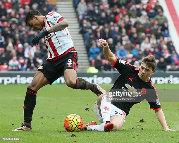 Donald Love of Manchester United in action with Patrick van Aanholt of Sunderland during the Barclays Premier League match between Sunderland and...