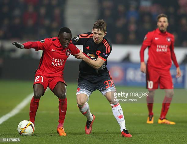 Donald Love of Manchester United in action with Pione Sisto of FC Midtjylland during the UEFA Europe League match between FC Midtjylland and...