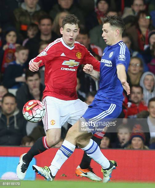 Donald Love of Manchester United U21s in action with Charlie Colkett of Chelsea U21s during the U21 Premier League match between Manchester United...