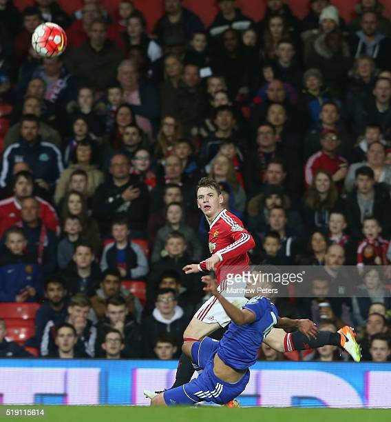 Donald Love of Manchester United U21s in action with Jake Clarke Salter of Chelsea U21s during the U21 Premier League match between Manchester United...