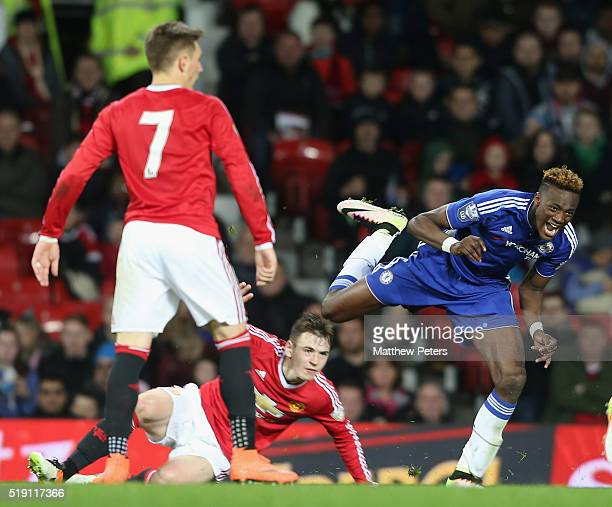 Donald Love of Manchester United U21s in action with Tammy Abraham of Chelsea U21s during the U21 Premier League match between Manchester United U21s...
