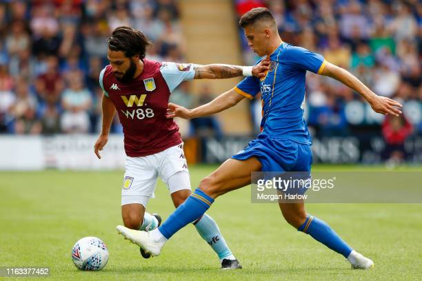 Donald Love of Shrewsbury Town is challenged by Jota of Aston Villa during the PreSeason Friendly match between Shrewsbury Town and Aston Villa at...