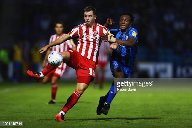 Donald Love of Sunderland battles for posession with Regan CharlesCook of Gillingham during the Sky Bet League One match between Gillingham and...