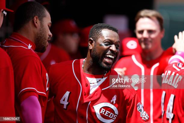 Donald Lutz of the Cincinnati Reds celebrates with teammate Brandon Phillips after hitting a threerun homer in the second inning against the...