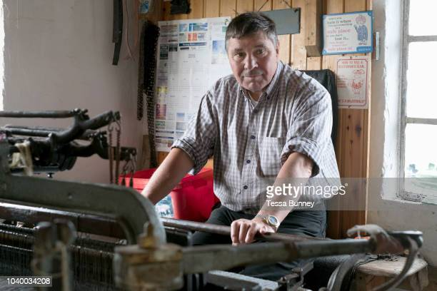 Donald MacDonald, Harris Tweed weaver, Shawbost, Isle of Lewis, Outer Hebrides, Scotland on 19 July 2018. Harris Tweed must be made from pure virgin...