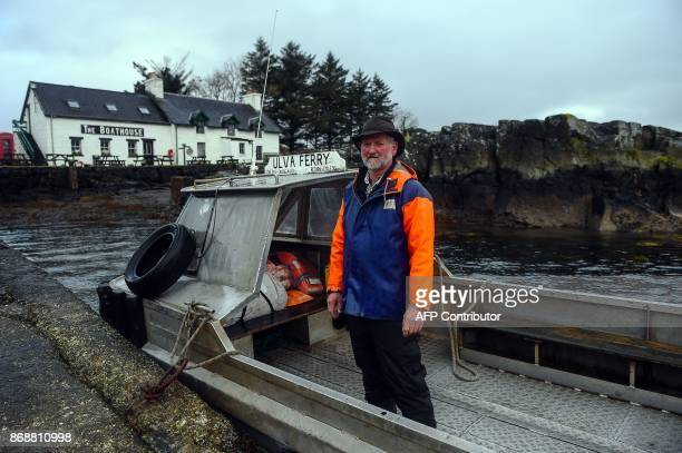 Donald Munro operator of the Ulva Ferry takes visitors across to the Isle of Ulva off Scotland's west coast on October 20 2017 When tycoons in...