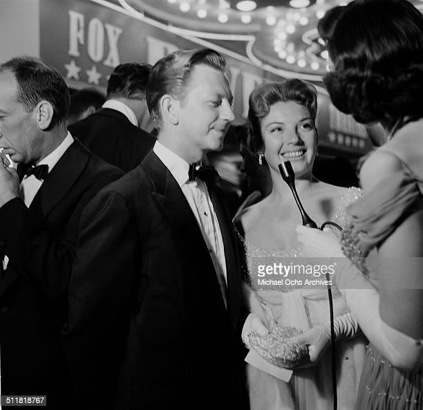 Donald O'Connor and wife Gloria Noble attend the movie premiere of Lust for Life in Los AngelesCA