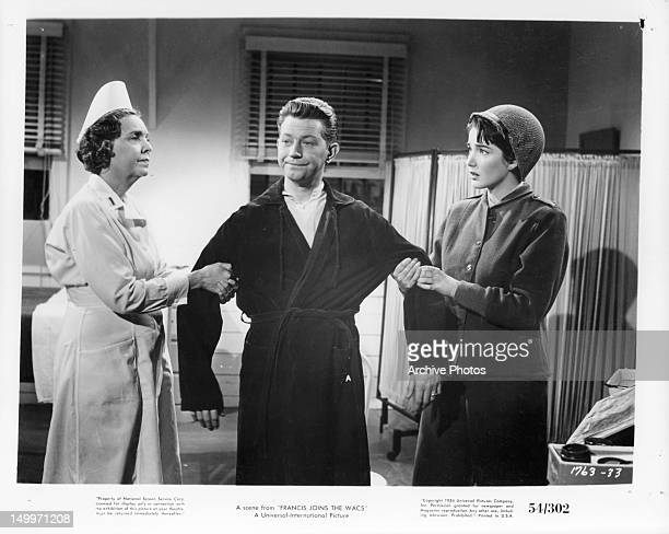 Donald O'Connor is pulled on by nurse and Julie Adams in a scene from the film 'Francis Joins The WACS' 1954