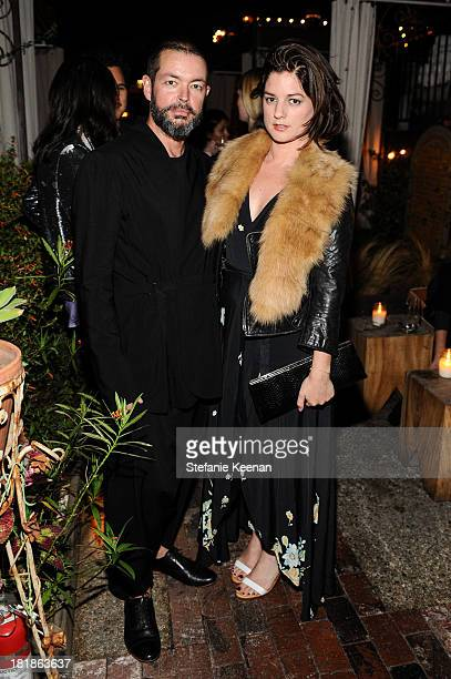 Donald Oliver and Ilaria Urbinati attend an intimate dinner event hosted by Elle magazine and J Brand at Petit Ermitage Hotel on September 25 2013 in...