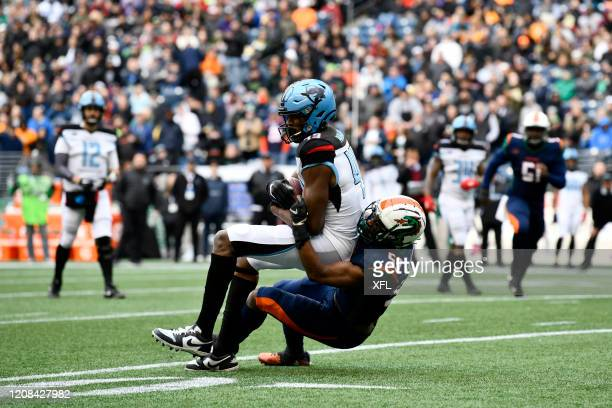 Donald Parham of the Dallas Renegades is tackled by Steven Johnson of the Seattle Dragons during the XFL game at CenturyLink Field on February 22,...
