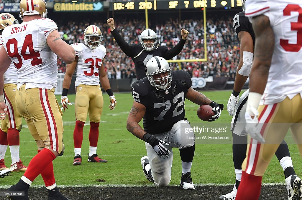 Donald Penn #72 of the Oakland Raiders finishes a touchdown run against the San Francisco 49ers in the second quarter at O.co Coliseum on December 7, 2014 in Oakland, California.