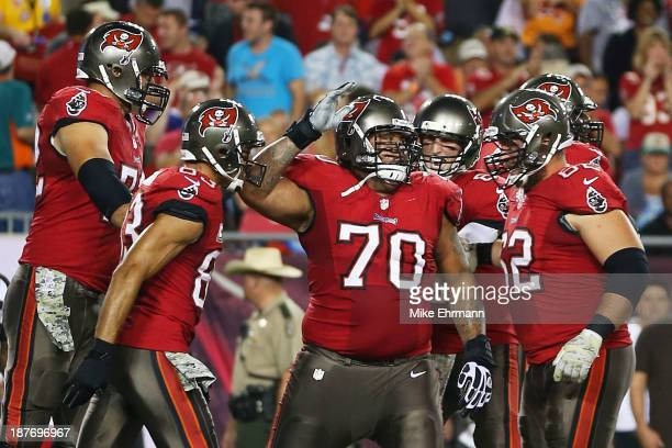 Donald Penn of the Tampa Bay Buccaneers celebtrates his first quarter touchdown against the Miami Dolphins teammates at Raymond James Stadium on...