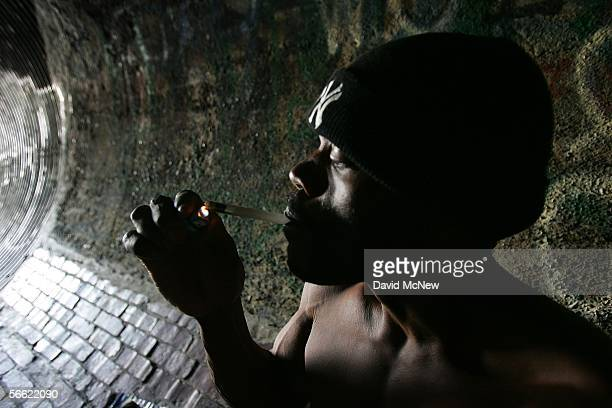 Donald Rayfield known on the street as Detroit smokes crack cocaine in an underground storm drain on January 18 2006 in Los Angeles California...