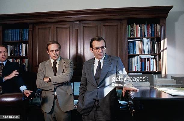 Donald Rumsfeld fingers his 'standup' desk in White House office 11/6 as he talks with his successor as White House Chief of Staff Richard B Cheney...