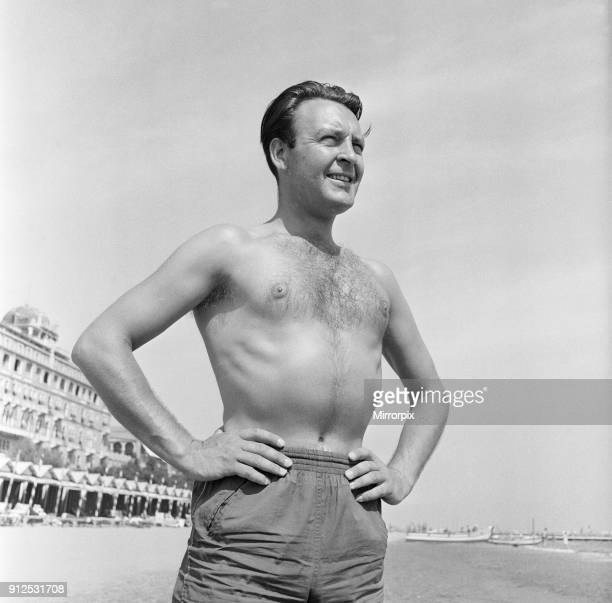 Donald Sinden seen here on the beach during the Venice Film Festival, 8th September 1955.