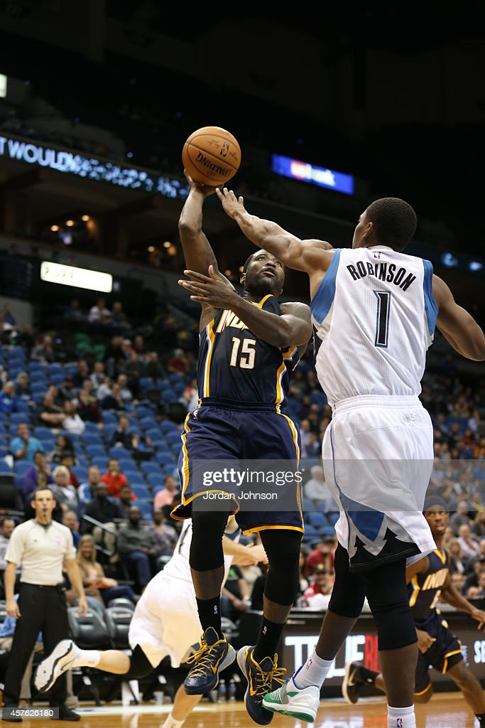 Donald Sloan #15 of the Indiana Pacers shoots against Glenn Robinson III #1 of the Minnesota Timberwolves on October 21, 2014 at Target Center in Minneapolis, Minnesota.