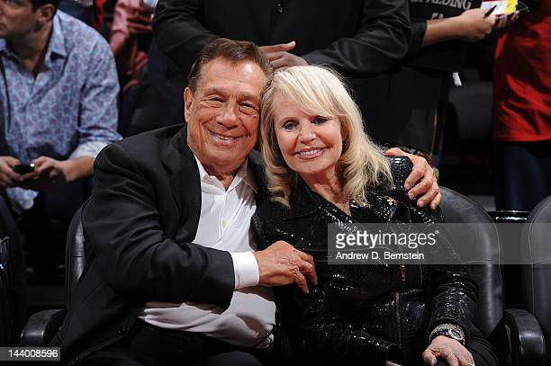Donald Sterling owner of the Los Angeles Clippers left and his wife Shelly pose for a photograph before his team played the Memphis Grizzlies in Game...