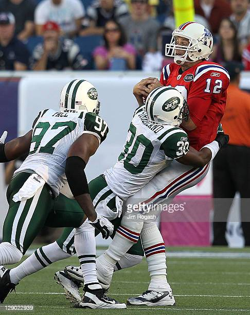 Donald Strickland of the New York Jets sacks Tom Brady of the New England Patriots in the second half at Gillette Stadium on October 9 2011 in...