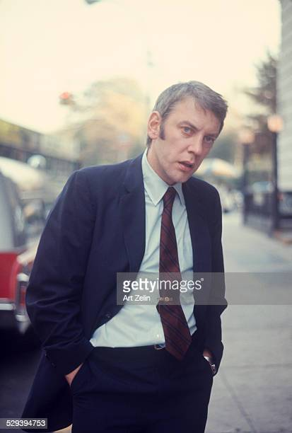 Donald Sutherland in a suit and tie on the street circa 1970 New York