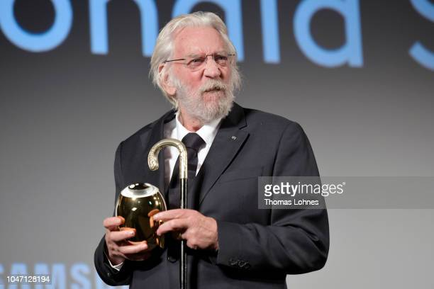 Donald Sutherland jokes around after receiving his Lifetime Achievement Award at the 'Ella John' premiere during the 14th Zurich Film Festival at...