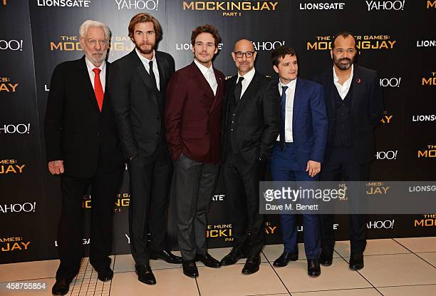 Donald Sutherland Liam Hemsworth Sam Claflin Stanley Tucci Josh Hutcherson and Jeffrey Wright attend the World Premiere of 'The Hunger Games...