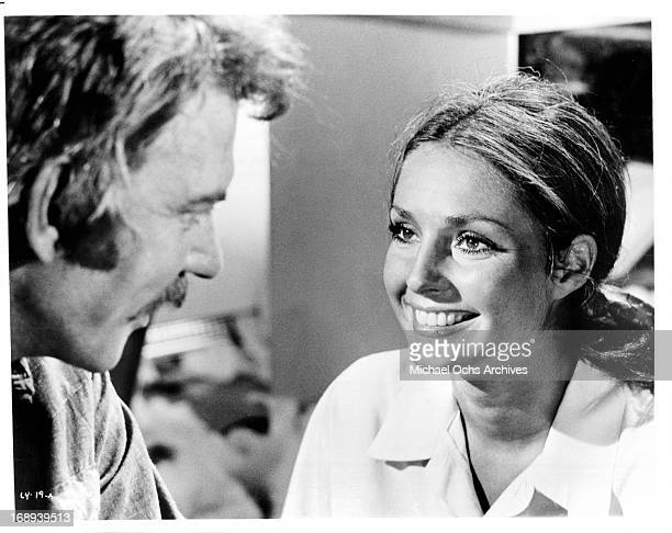 Donald Sutherland looks to Jennifer O'Neill in a scene from the film 'Lady Ice' 1973
