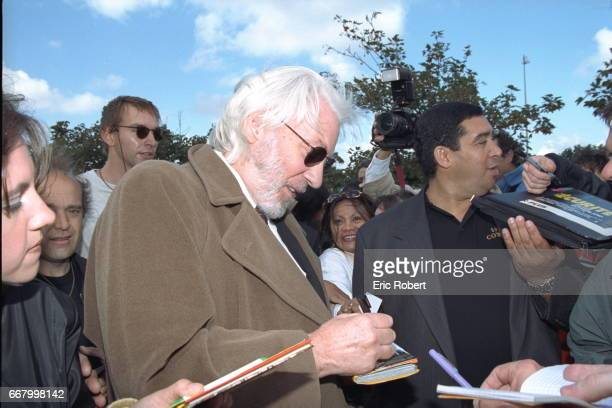 Donald Sutherland one of the stars of Clint Eastwood's 'Space Cowboys' signing autographs