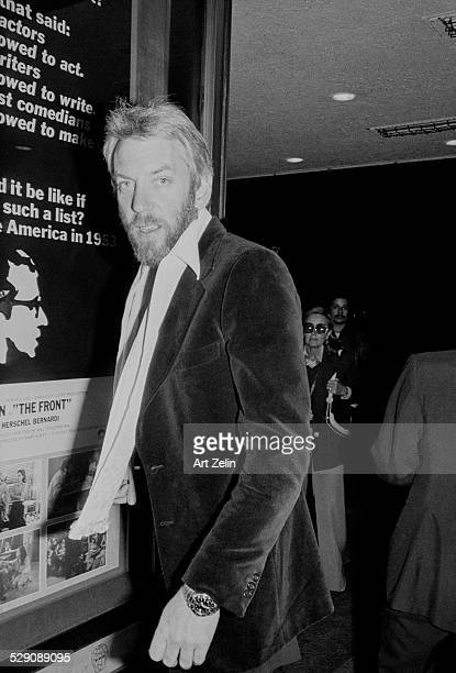 Donald Sutherland outside the theater showing The Front circa 1970 New York