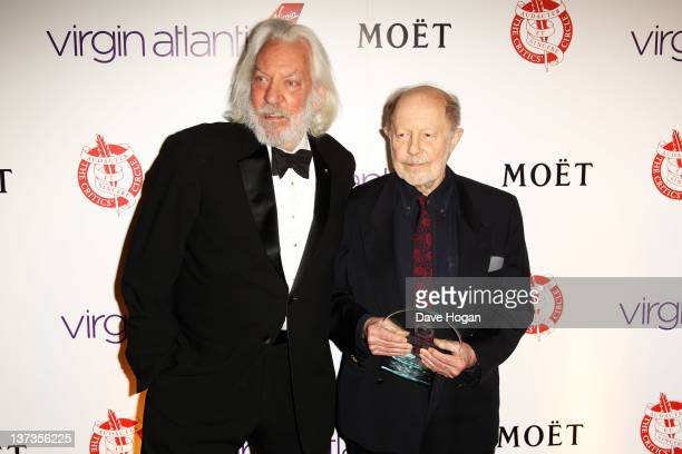 Donald Sutherland poses with Nicolas Roeg after presenting him with his Excellence In Film Award in the press room at the London Film Critics' Circle...
