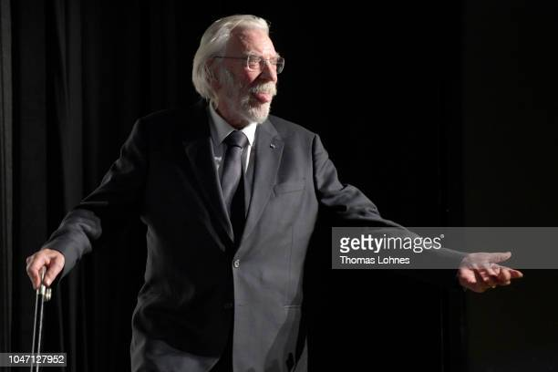 Donald Sutherland sticks out his tongue as he enters the stage to receive his Lifetime Achievement Award at the 'Ella John' premiere during the 14th...