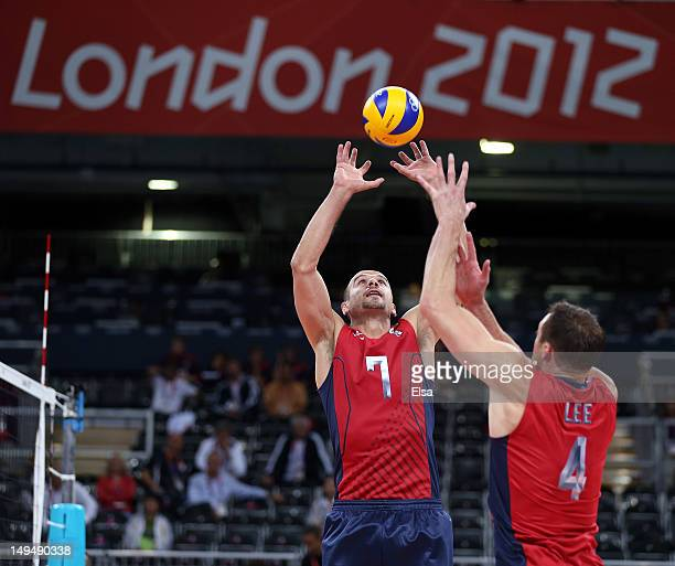 Donald Suxho of United States sets the ball as David Lee of the United States stands by during Men's Volleyball on Day 2 of the London 2012 Olympic...