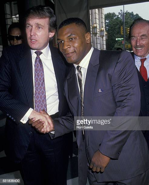 Donald Trum Mike Tyson and Fred Trump attend Mike Tyson Press Conference on July 26 1988 at the Plaza Hotel in New York City