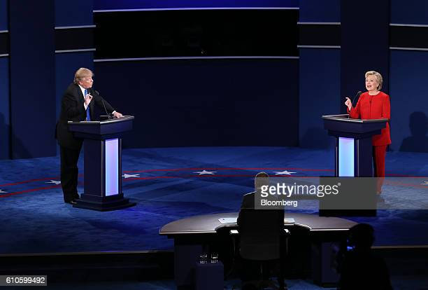 Donald Trump 2016 Republican presidential nominee and Hillary Clinton 2016 Democratic presidential nominee speak during the first US presidential...