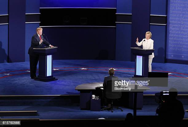 Donald Trump 2016 Republican presidential nominee and Hillary Clinton 2016 Democratic presidential nominee speak during the third US presidential...