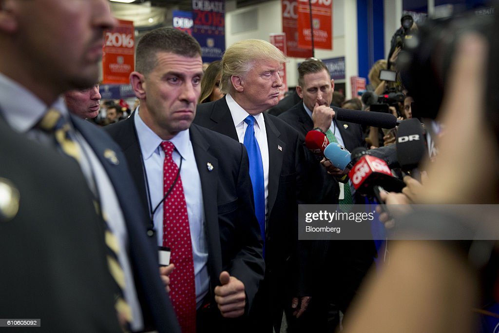 Donald Trump, 2016 Republican presidential nominee, center, speaks to the media following the first U.S. presidential debate at Hofstra University in Hempstead, New York, U.S., on Monday, Sept. 26, 2016. Hillary Clinton and Trump leveled sharp and personal charges and counter-charges over trade, the U.S. economy, race and foreign policy in their first face-to-face debate, an event that put on display their starkly different personalities and visions of the nation's future. Photographer: Daniel Acker/Bloomberg via Getty Images