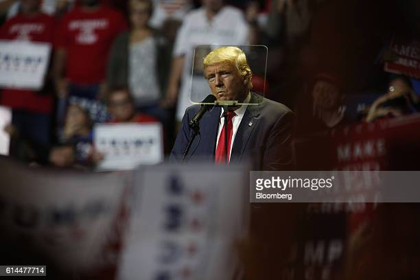 Donald Trump, 2016 Republican presidential nominee, is seen through a teleprompter as he speaks during a campaign event in Cincinnati, Ohio, U.S., on...