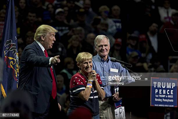 Donald Trump 2016 Republican presidential nominee left points to attendees as Barbara Zawistowski Rone center and Hugh Rone parents of deceased Trump...