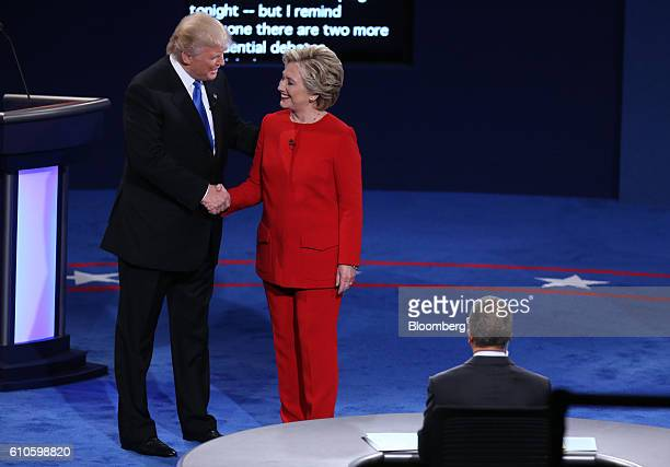Donald Trump 2016 Republican presidential nominee left shakes hands with Hillary Clinton 2016 Democratic presidential nominee during the first US...