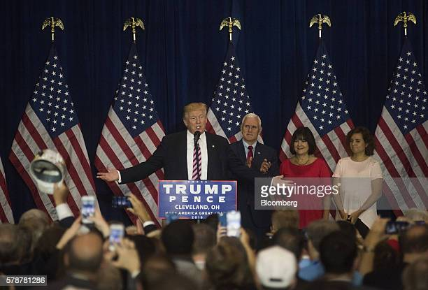 Donald Trump 2016 Republican presidential nominee left speaks as Mike Pence 2016 Republican vice presidential nominee applauds during a goodbye...