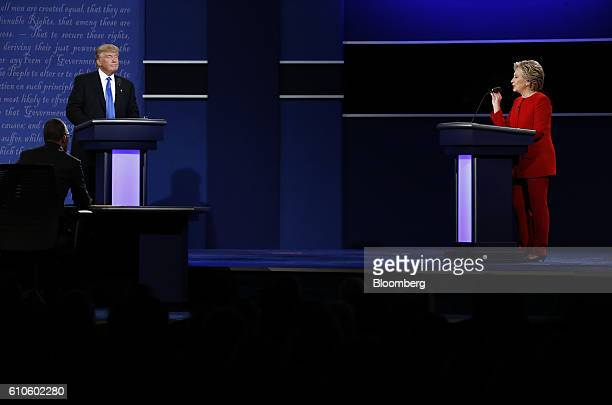 Donald Trump 2016 Republican presidential nominee listens as Hillary Clinton 2016 Democratic presidential nominee speaks during the first US...