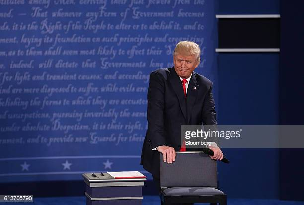 Donald Trump 2016 Republican presidential nominee reacts during the second US presidential debate at Washington University in St Louis Missouri US on...