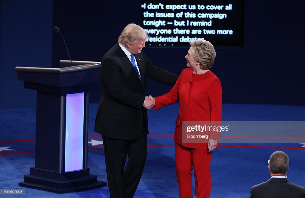 Donald Trump, 2016 Republican presidential nominee, shakes hands with Hillary Clinton, 2016 Democratic presidential nominee, during the first U.S. presidential debate at Hofstra University in Hempstead, New York, U.S., on Monday, Sept. 26, 2016. Clinton and Trump meet Monday night for a presidential debate that will give them their broadest exposure to voters and promises to be a pivotal moment in a long and increasingly close race. Photographer: Daniel Acker/Bloomberg via Getty Images